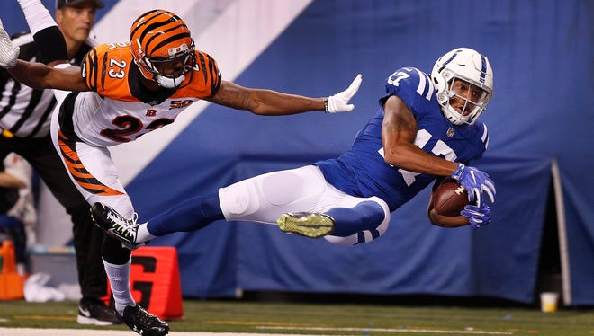 Indianapolis Colts wide receiver Justice Liggins (17) makes a diving catch for a touchdown behind Cincinnati Bengals cornerback Bene' Benwikere (23) in the second half of their preseason football game Thursday, August 31, 2017.