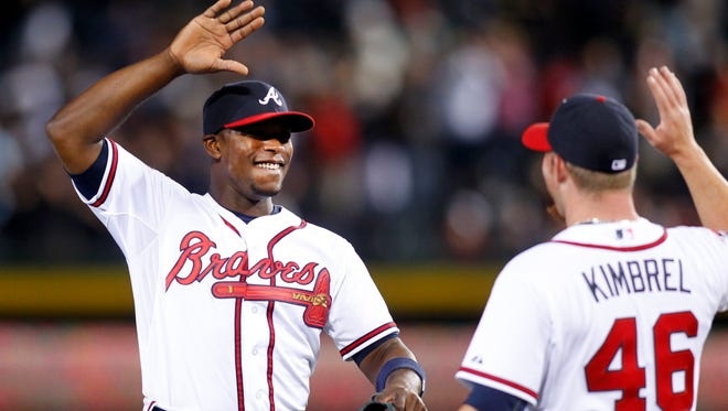 Atlanta Braves left fielder Justin Upton and relief pitcher Craig Kimbrel celebrate a victory against the Cincinnati Reds at Turner Field.