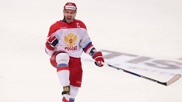 FILE - In this Dec. 19, 2015, file photo, Russia's Ilya Kovalchuk celebrates after scoring during the second period action of the Channel One Cup ice hockey match against Finland in Moscow, Russia. New Jersey Devils general manager Ray Shero has had talks with Ilya Kovalchuk's agent regarding the former No. 1 draft pick's pending return to the NHL four years after bolting to play in his native Russia.
