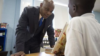 April 2, 2015 -   Shelby County Schools Superintendent Dorsey Hopson (left) talks with Dunbar Elementary School second-grader Tredarius Young, 8. (Brandon Dill/Special to The Commercial Appeal)