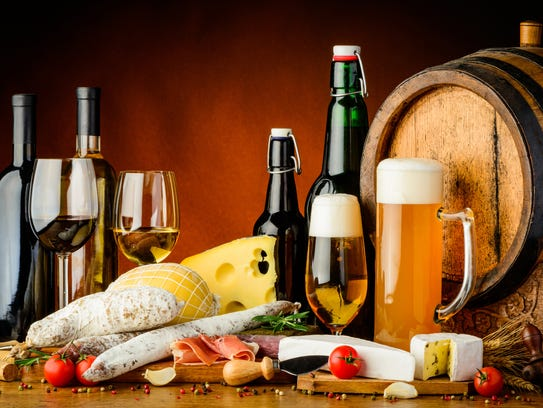 still life with wine, beer, traditional food, cheese