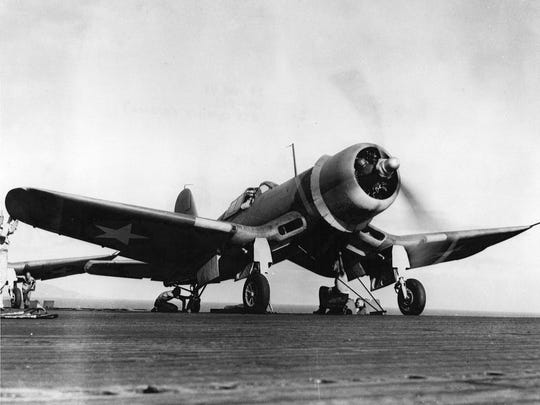 F4U-1 Corsair fighter of U.S. Marine Corps fighter squadron VMF-213 'Hell Hawks' being prepared for flight aboard USS Copahee, March 29,1943.