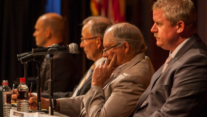 Iron County commissioner candidates listen to a question from debate moderators at Southern Utah's Great Hall, Wednesday, June 8, 2016.