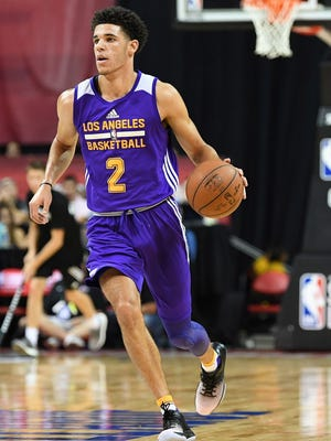 Los Angeles Lakers guard Lonzo Ball (2) dribbles during an NBA Summer League playoff game against the Dallas Mavericks.