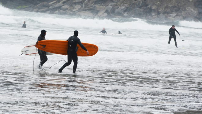 Surfers hit the waves at Short Sand Beach within Oswald West State Park. Surfers hit the waves at Short Sand Beach at Oswald West State Park along the northern Oregon coastline on Tuesday, March 26, 2013.