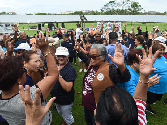 Manamko' participate in a team-based, organizational game during the third annual Huegon-Manamko' Senior Games at the Governor Joseph Flores Beach Park in Tumon on April 27, 2018.
