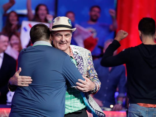Scott Blumstein, left, embraces John Hesp, of of Britain, after Hesp was knocked out of the final table during the World Series of Poker, Friday, July 21, 2017, in Las Vegas. Hesp finished in fourth place. (AP Photo/John Locher)