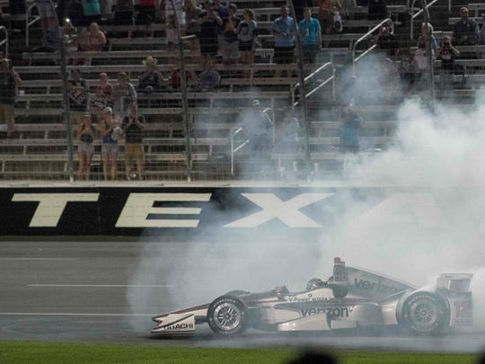 IndyCar Series driver Will Power (12) celebrates winning the Rainguard Water Sealers 600 at Texas Motor Speedway.