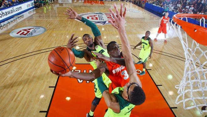 Syracuse Orangemen forward Jerami Grant goes up for a shot between Baylor Bears forward Cory Jefferson and center Isaiah Austin during the championship game of the EA Sports Maui Invitational.