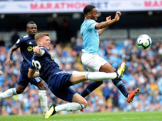 Britain_Soccer_Premier_League_73447.jpg