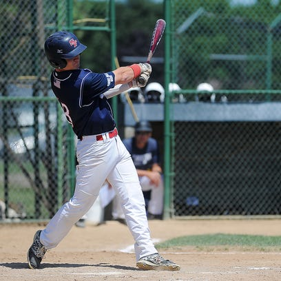 """Sioux Falls West Post 15's Sam Lang (13) hits a double during a 2015 South Dakota American Legion Class """"A"""" State Tournament game against Yankton Post 12 on Sunday, Aug. 2, 2015, at Bob Shelden Field in Brookings, S.D."""
