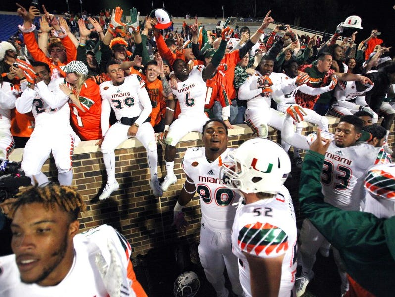 Oct 31, 2015; Durham, NC, USA; The Miami Hurricanes celebrate with their fans after beating the Duke Blue Devils 30-27 at Wallace Wade Stadium. Mandatory Credit: Mark Dolejs-USA TODAY Sports ORG XMIT: USATSI-227118 ORIG FILE ID: 20151031_pjc_ad5_551.JPG