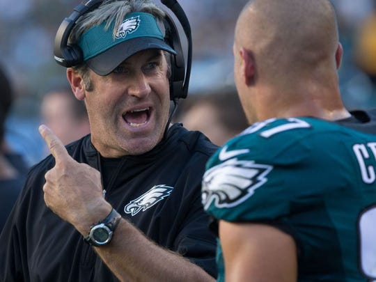 ]Eagles head coach Doug Pederson gives instruction to tight end Brent Celek during a Sept. 25 game against Pittsburgh.