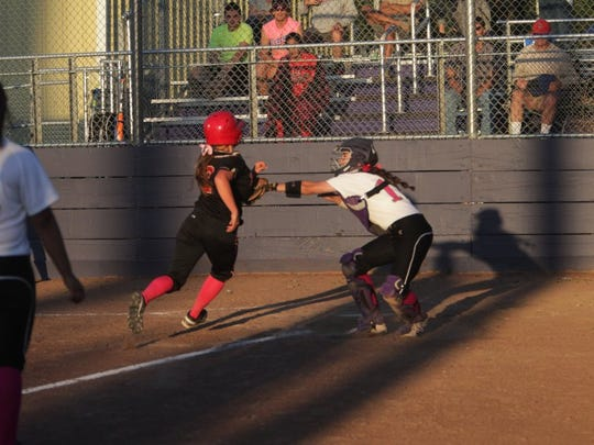 Shasta High catcher Alyssa Pope tags out Foothill's London Anstine during a 2016 game.