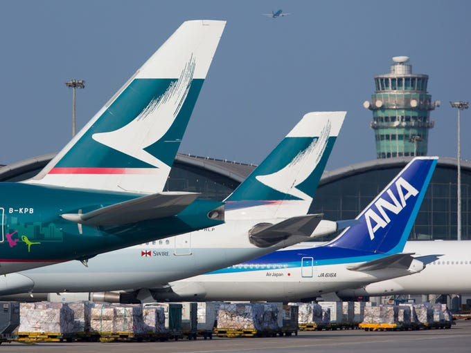Airplanes are prepped for departure from Hong Kong