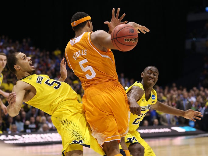 TennesseeÕs Jarnell Stokes gets called for charging as he tries to gets past MichiganÕs Jordan Morgan and MichiganÕs Caris LeVert on a big play in the final seconds that cost Tennesse a chance to take the lead. Tennessee faced off with Michigan in the first  game of the NCAA Regional at Lucas Oil Stadium in Indianapolis Friday, March 28, 2014.