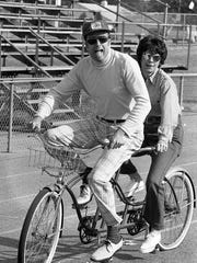 Journal & Courier city editor Bob Kriebel, rides in tandem wth wife Nancy at the first annual Jeff 'Little 100' bike race at the Jefferson High School track. Photo taken May 4, 1974.