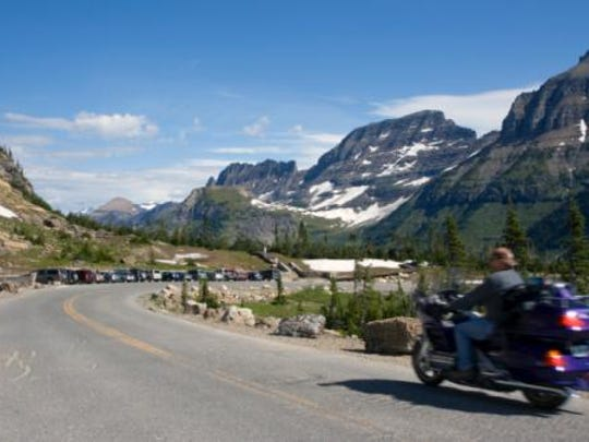 A motorcycle makes its way over the Going-to-the-Sun Road in Glacier National Park.