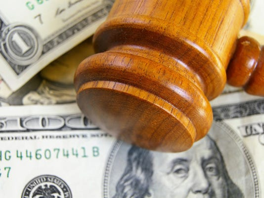gavel with money zimmytws istock.jpg