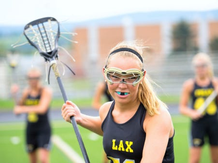 Intense look from female lacrosse player