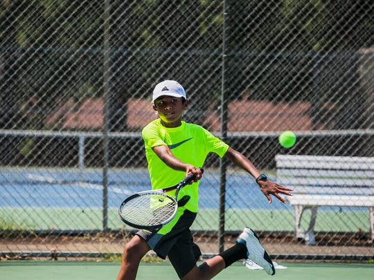 July 25, 2017 - Kartik Mandla, 11, returns the ball to LeMoyne Owen tennis player, Cody Coins, not pictured, during morning practice at the Eldon Roark Tennis Center in Whitehaven on Tuesday. Mandla, a rising tennis star from Collierville, is one of only 24 youths around the nation selected to train with the United States Tennis Association.