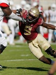 Florida State Seminoles defensive end Josh Sweat (9) applies defensive pressure during the second quarter against the Delaware State Hornets and the Florida State Seminoles at Doak Campbell Stadium on Nov 18, 2017, Tallahassee, Fla.