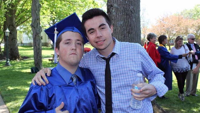 Preston Schrader (left), 18, and Mark Valentine, 18, at Schrader's graduation from Grand River Academy in May 2015.
