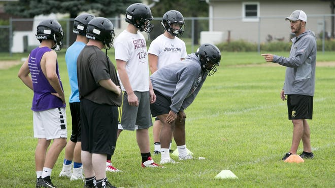Like the rest of the state's high school coaches, Lena-Winslow's Ric Arand, pictured talking with his team during the first day of practice back on Aug. 6, 2018, is awaiting word from the IHSA on how they can move forward with summer workouts and preparation for the fall seasons.