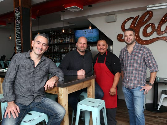 Chef Dennis Cruz, second from right, with co-owners