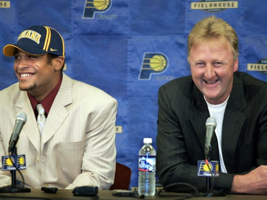 David Harrison and Larry Bird shared a laugh after Harrison was drafted late in the first round in 2004.