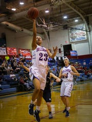 Las Cruces High's Janessa Johnson scores during Friday's Class 6A state tournament first round game at LCHS.