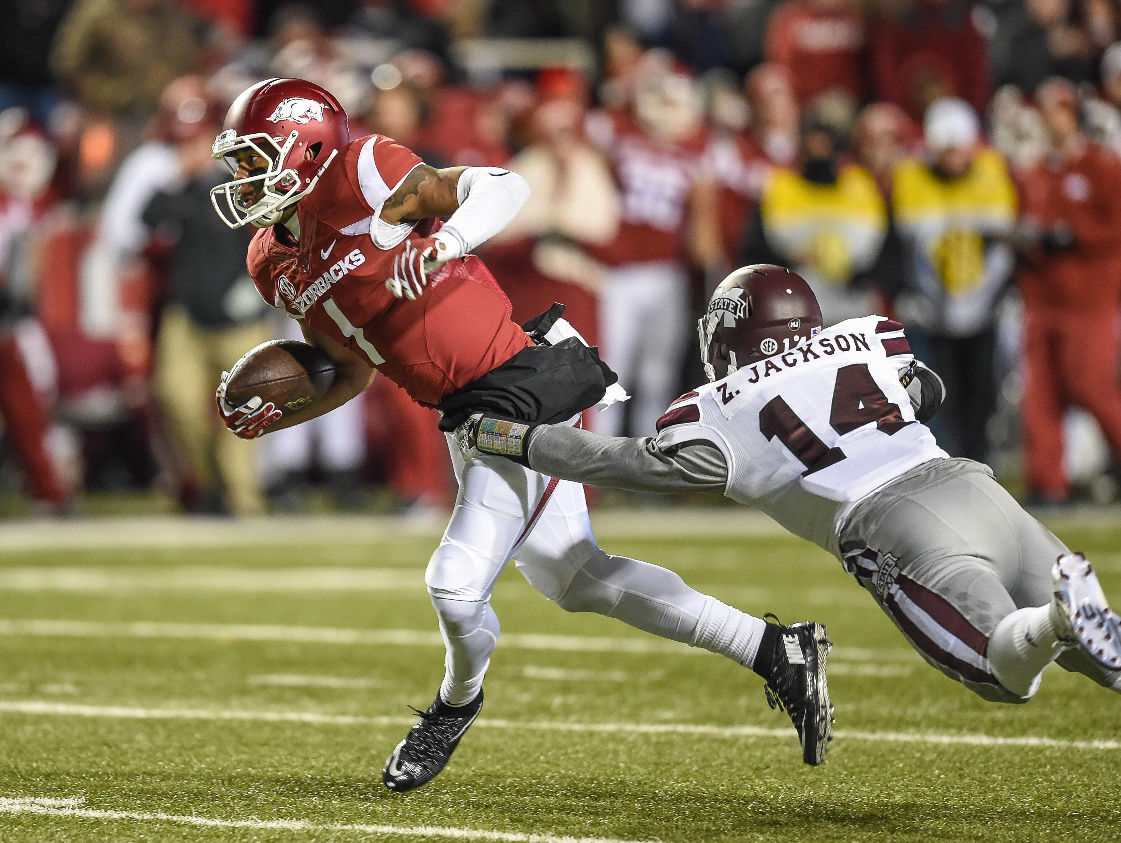 Arkansas wide receiver Jared Cornelius (1) with a pass reception during a game between Arkansas and Mississippi State on Saturday night in Fayetteville.