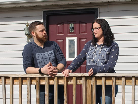 Crystal and Devin Durain stand outside of their Marion