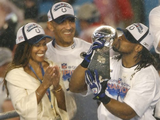 Indy's Tony Dungy, with wife Lauren, celebrate with