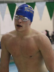 Senior tri-captain Drew Hoelscher helped lead Farmington Harrison's 400-yard freestyle relay team to a meet-clinching victory Thursday evening in Birmingham.