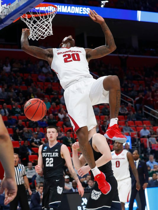 Arkansas forward Darious Hall (20) dunks against Butler during the first half of an NCAA men's college basketball tournament first-round game in Detroit, Friday, March 16, 2018. (AP Photo/Paul Sancya)