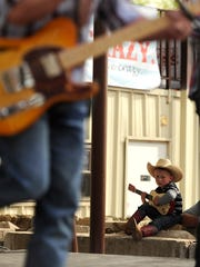 Bubba Crabtree, 4, strums along on his guitar as Kyle