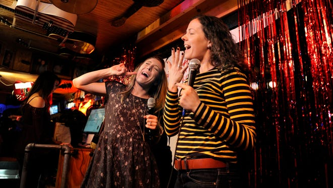 LeAnne Wagner, left, and Angie Homan sing karaoke on stage at Lonnie's Western Room in Printers Alley on March 3.
