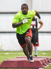 Linebacker Otha Peters runs a drill during UL's recent Pro Day.