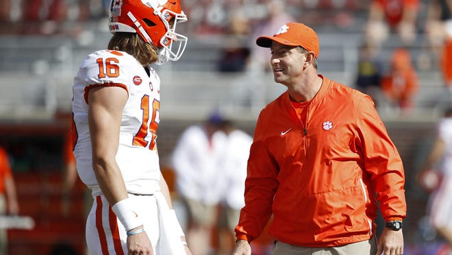 Head coach Dabo Swinney of the Clemson Tigers talks to quarterback Trevor Lawrence #16 before the game against the Florida State Seminoles at Doak Campbell Stadium on October 27, 2018 in Tallahassee, FL.