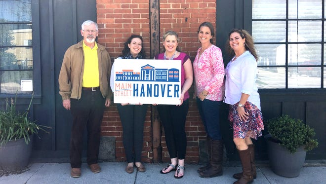 Main Street Hanover was presented with a $2,000 check from The Vault Theater in May. From left, are: Victor Scuikas, Justine Kilkelly Trucksess, Brittany Stevens-Reese, Heather Sheppard Lunn and Elizabeth Johnides.