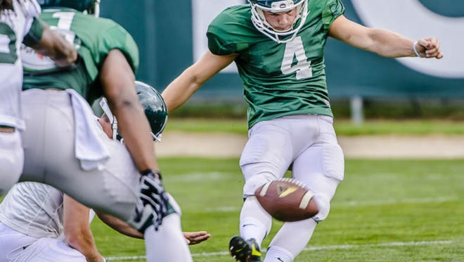 MSU kicker Michael Geiger kicks a field goal during a summer camp practice Wednesday August 6, 2014 at the Duffy Daugherty Building in East Lansing.