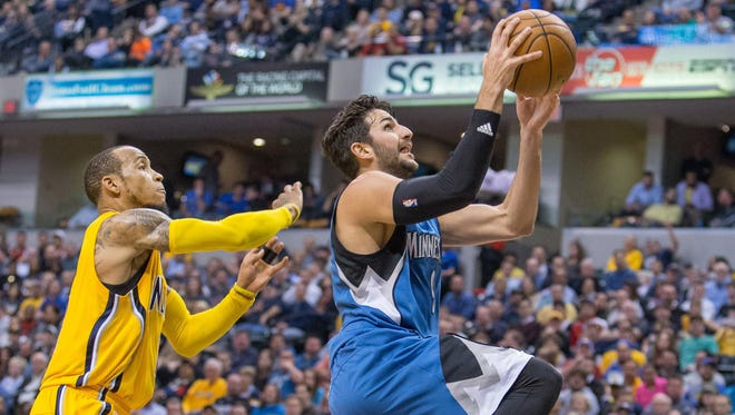 Minnesota Timberwolves guard Ricky Rubio shoots the ball while Indiana Pacers guard Monta Ellis defends in the first half of the game at Bankers Life Fieldhouse.