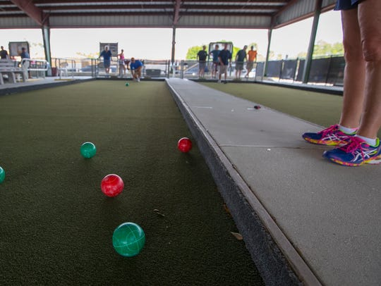 Friends enjoy a game of bocce at the courts in Cape