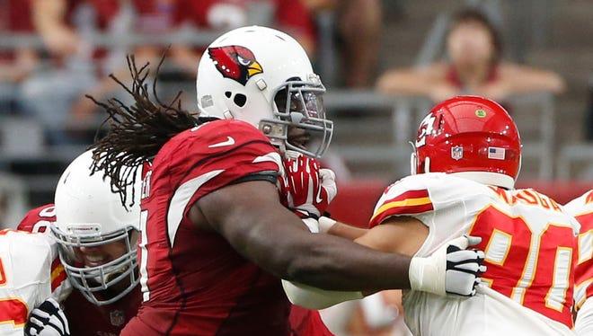 Arizona Cardinals LG Jonathan Cooper blocks Kansas City Chiefs LB Josh Mauga during NFL action at University of Phoenix Stadium in Glendale on December 7, 2014.