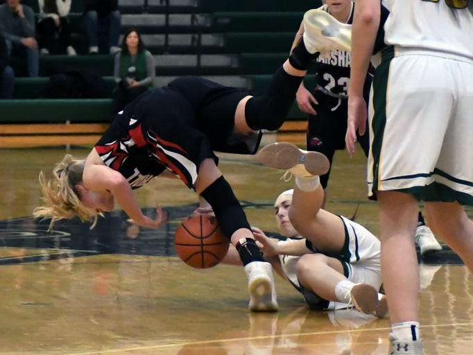 Marshall's Natalie Tucker (5) dives for a loose ball