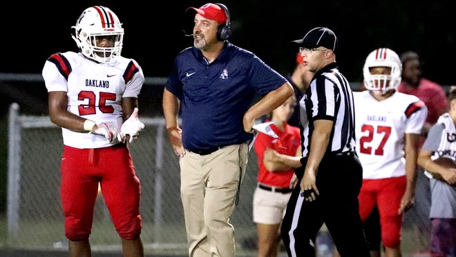 Oakland coach Kevin Creasy talks to Tim Pannell (25) during a recent game. Creasy's Patriots will play host to Blackman in a key 3-6A contest Friday.