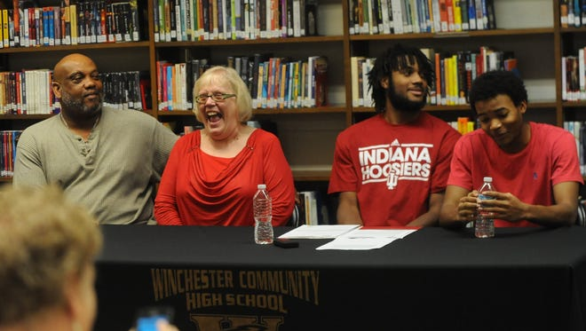 Grandfather Dwight Enis, grandmother Judy Enis, Kiante Enis and younger brother Boo Enis during a ceremony to announce Kiante's college football choice Wednesday.