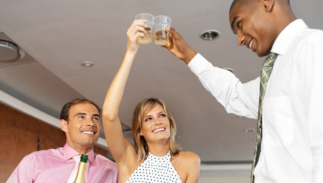 Co-workers toasting in the office