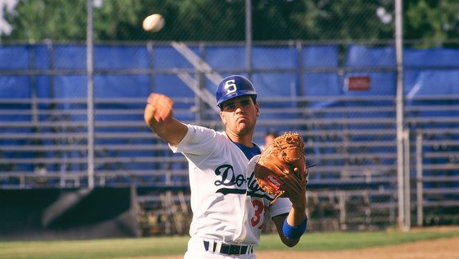 Mike Piazza converted from first base to catcher in his first year of professional baseball with the Salem Dodgers.